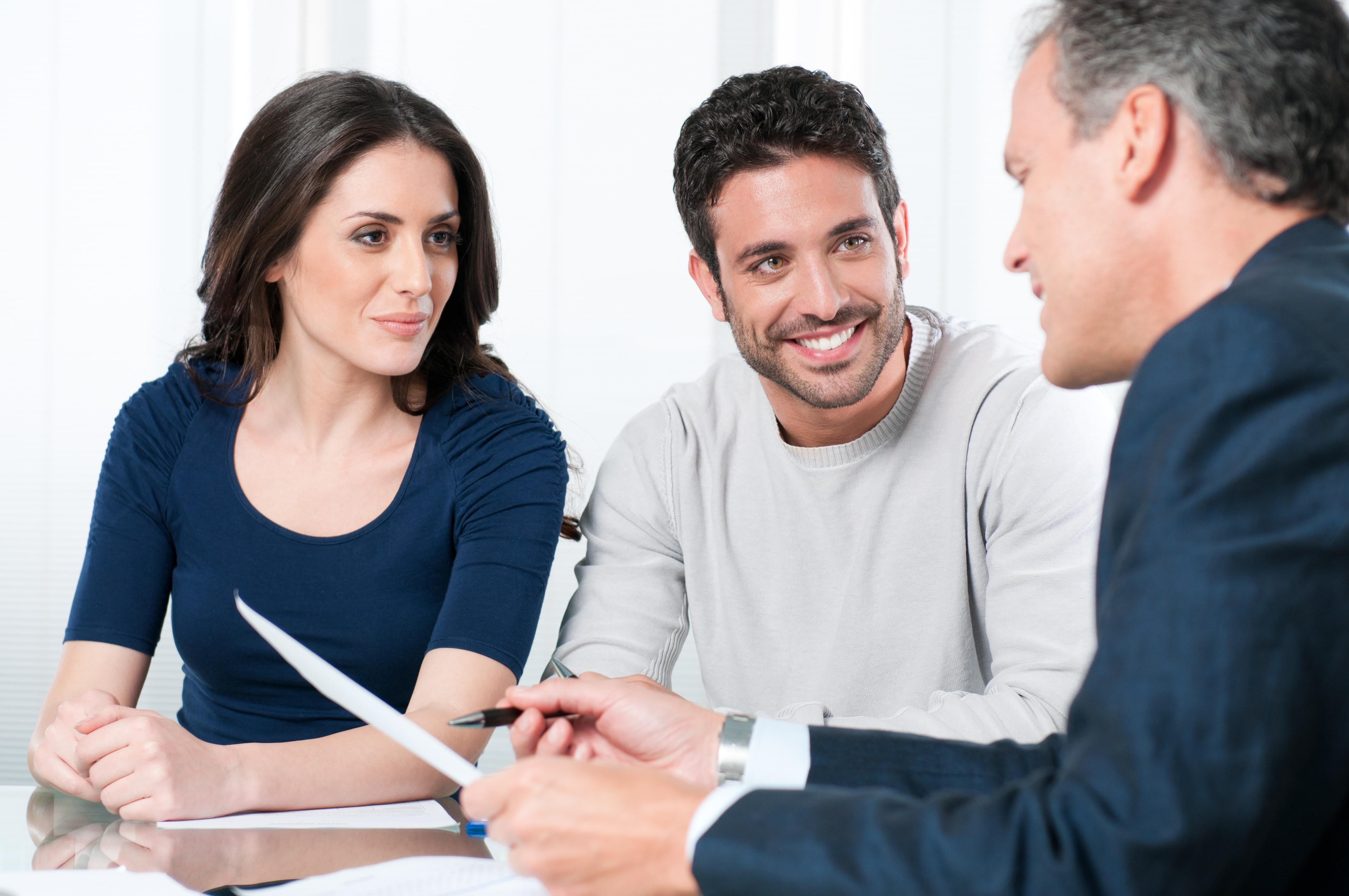 Financial consultant reviews investments with a couple